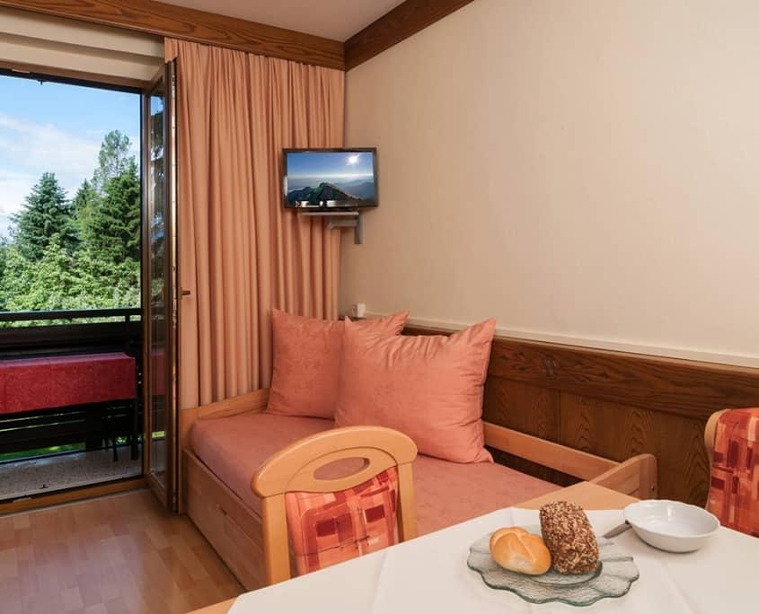 Apartment Abendrot mit Wohnraum und Balkon